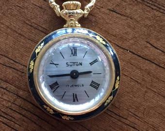 Vintage sutton swiss ladies goldtone watch pendant mechanical ornate black/gold floral design w/chain c 1960s