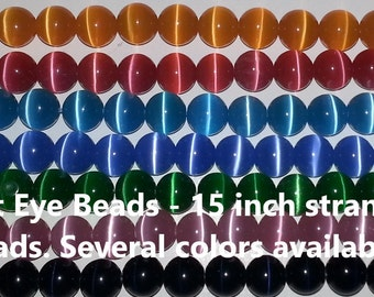 50 bead strand of 8mm Cats Eye Beads. Variety of colors available
