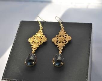 """Orecchini """"Haute Couture"""" oro e nero."""