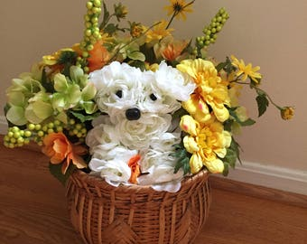 Adorable puppy snuggled in a fall basket