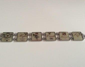 Beige, black and red square cabochon bracelet.