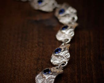 Silver bracelet and sapphires.
