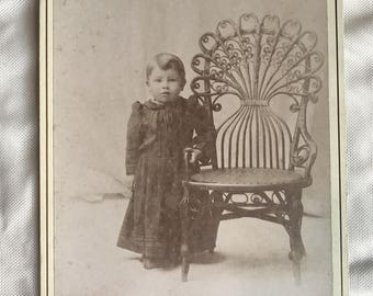 Antique cabinet card of sweet little boy standing next to chair