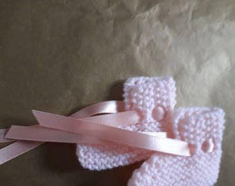 Hand-knitted pink baby booties