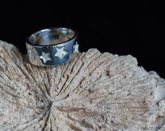 Silver ring with star design, EU size 18.25 - 18.5