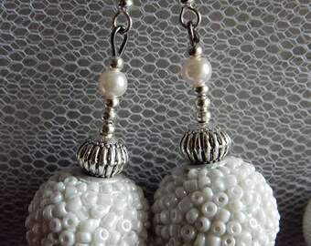 White and Silver earrings.