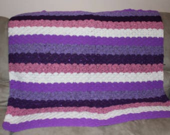 This a hand crochet  lap blanket