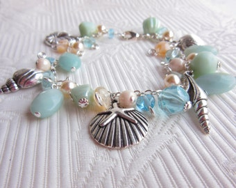 Silver Seashell Bracelet with Amazonite gemstones, pearls and pretty glass beads. Silver link chain bracelet.