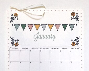 2018 Wall Calendar, size 8.5x11 inches featuring 12 different illustrations in green, teal, aqua, gray, yellow, pink, brown and taupe