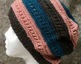 slouchy, messy-bun hat in blue, pink, and grey wool