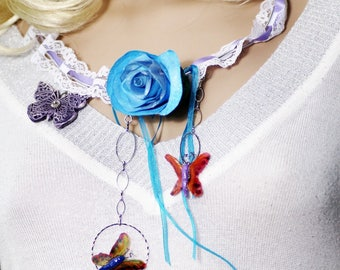 Creative necklace: flying butterflies around a handmade rose fabric