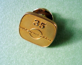 10K GOLD  35 NBC Universal Badge