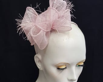 pale lilac sinamay fascinator on headband fixing ideal weddings races accessory