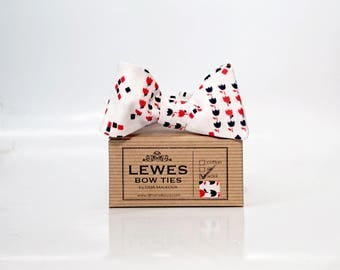 Men's cream wool self tie bow tie with red and black graphic tulips and squares, graphic print self-tie bow tie, cream red and black bow tie