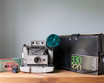 Vintage 1960's Polaroid Land Camera Model 330 with Original Hardbody Case, Flash, Bulbs, Timer and Manual