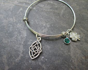 Celtic Knot Adjustable bangle bracelet in Stainless Steel with Emerald Swarovski bezel charm and Four Leaf Clover Charm Irish Jewelry