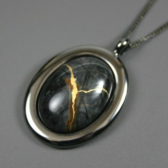 Kintsugi (kintsukuroi) Picasso jasper oval stone cabochon pendant with gold repair in gunmetal setting on curb chain - OOAK