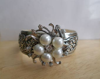 Silver Tone Cuff Bracelet with a Silver, White Pearl and Clear Rhinestone Center