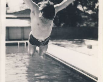 Man diving into swimming pool, Vintage photograph c1930s