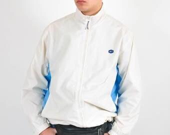 Vintage 90's NIKE windbreaker jacket in white