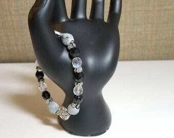 Stretch bracelet of black, gray, and white