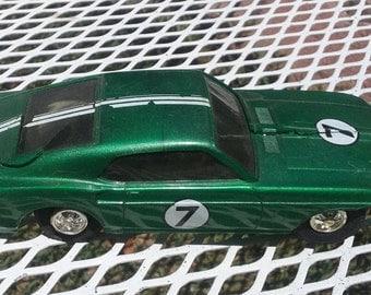 Slot Car vintage mid size 1960s era green mustang number 7 seven