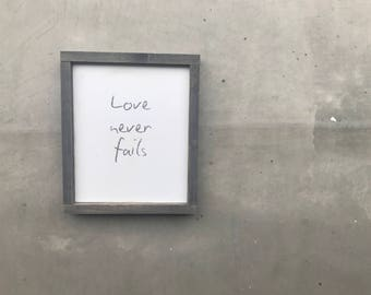 Love Never Fails Wood Sign