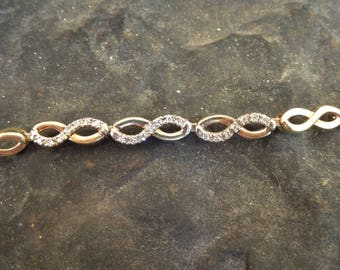 14K Yellow Gold and Diamond Swirl Link Bracelet