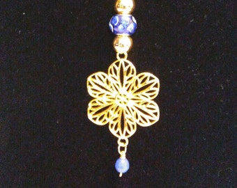 18k gold plated flower with18k gold plated hearts chain.