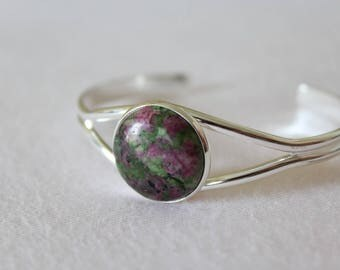 Galaxy bracelet with fuchsite round cabochon.