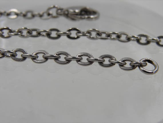 3.3mm Stainless steel chain w/stainless lobster claw clasp. Micro tig welded jump rings. *Bulk purchased to offer you wholesale prices*