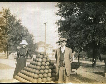 Antique Photo of Woman with Her Hand on a Pile of Cannon Balls 1910's, Original Found Photo, Vernacular Photography, Pensacoloa, Florida