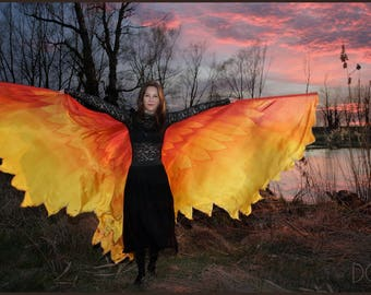 Phoenix wings. Hand painted silk bird wings, feathers in colors of red, orange and yellow.