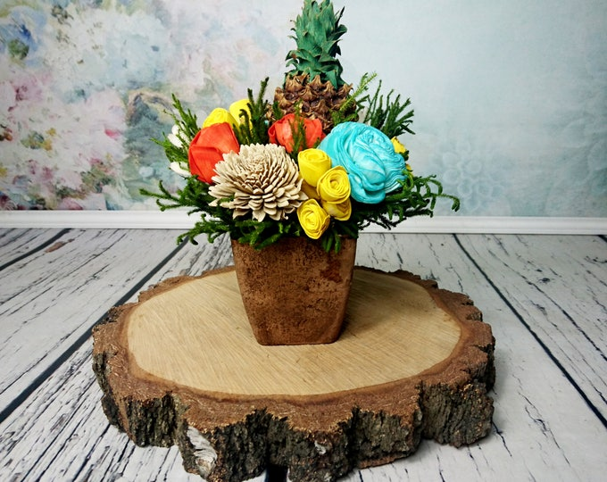 Tropical paradise wedding centerpiece with pineapple