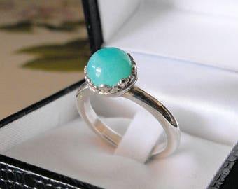 925 silver, or in 18 Kt gold, ring with amazonian, diameter 8 mm, cut cabochon.