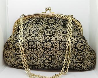 Vintage evening bag . black and gold kisslock bag.