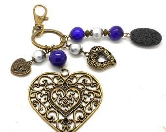 A scent! bronze bag charm, grey and blue beads heart charms