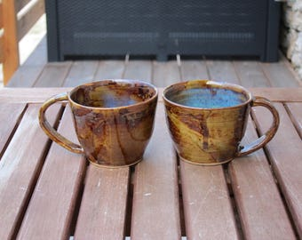 2 Brown and blue-green stoneware coffee cups