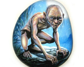 Gollum Portrait Hand painted Rock! Is Painted with high quality Acrylic paints and finished with Glossy varnish protection.