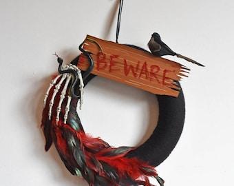 BEWARE! Handmade black bird, feather, snake and skeleton Halloween Wreath