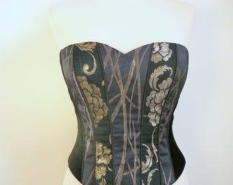 Strapless corset - black velvet and gold jacquard patterns.