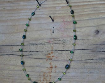 Leaf charm green glass floating bead necklace