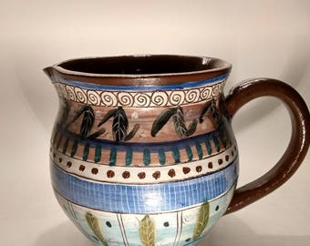 Hand made decorated jug