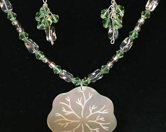 Iridescent Etched Balinese Shell Pendant with beaded necklace and matching earrings.