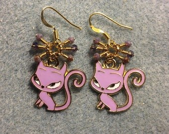 Violet enamel devil cat charm earrings adorned with tiny dangling violet and purple Chinese crystal beads.