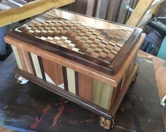 Hardwood laminated jewelry box with slide-hinge top.