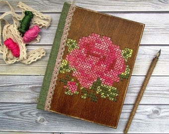 Wooden book for records with handmade embroidery, notebook in a wooden cover, wedding guest book with aged paper.