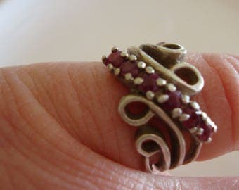 925 Sterling Silver fanciful ring with ruby-coloured stones