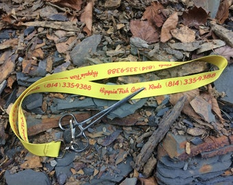 Fishing pliers with lanyard