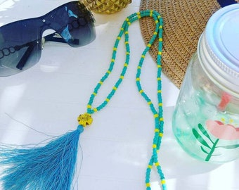 Long tassel and turquoise blue and yellow beads, blue tassel
